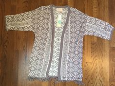 This cardi is so amazing. See more from my August 2015 Fix on www.amonkeyandhismama.com #stitchfix #tribal #cardigan