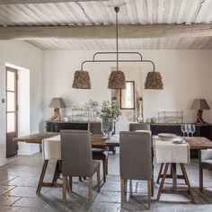 Decorate a home in modern rustic style dining room raw beam ceiling