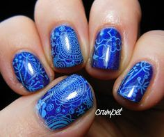 Darling Diva Nightbird stamped with a variety of images from MoYou plate Pro 14 and a Konad pale blue polish | The Crumpet