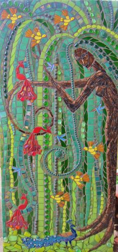 The Contented Willow - Tree Goddess Mosaic   Frances Green Stained glass, nuggets, mille, tiles, beads, glass jewels, irridescent glass and broken crockery on MDF backing, 39 x 85 cm. Grouted in charcoal, with some painted grout lines.  The Goddess finds happiness in birds of all colours and sizes, and values birds in the bush above all others...  This is my entry to the PieceMakers Bird Challenge. It won first place, yay!!!  piecemakersmosaics.blogspot.ch/