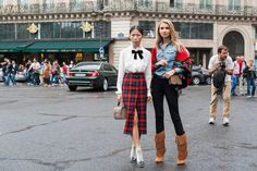 Oksana On - PFW Street Style Day 6 A prim and proper plaid look stood by her boho counterpart