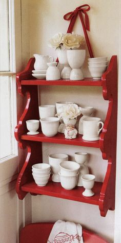 I like this cute red shelf with all white. I bought a shelf for the nursery nearly 20 years ago that is not being used and is similar to this. Great idea for it!