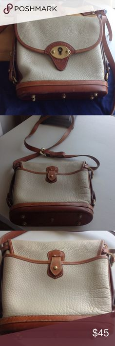 "Dooney & Bourke All weather Leather  9""X9 1/2"" 2 3/4"" across the bottom, the bottom has metal feet, the hardware on this bag is beautiful! this hand bag has a couple worn spots, on each side, but other wise is in good condition, shoulder strap, can be worn cross body! Dooney & Bourke Bags Shoulder Bags"