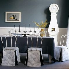 CUTE! Gray dining room with yellow accents...like the gray color with yellow accents.  Not so much the decorations!