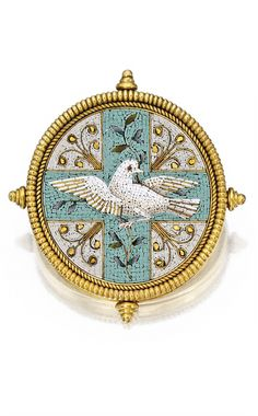 Gold and Micromosaic Brooch, Castellani. The circular micromosaic depicting a dove brandishing a laurel branch, composed of tesserae in white, gray, turquoise, olive and gold hues, within a ropetwist frame accented by four finials, signed with interlocking Cs; circa 1865.