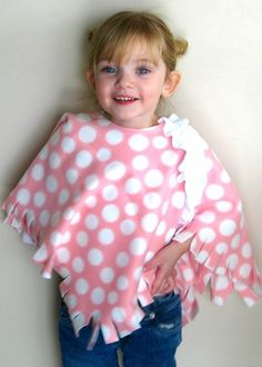 "Toddler Fleece Poncho: This can be as simple as you want to make it! A fun no-sew project. Just cut the fleece and you are done! of a yard will make 2 of these babies! She loves her ""shoulder blanket"" :) Fleece Crafts, Fleece Projects, Sewing For Kids, Baby Sewing, Diy For Kids, Free Sewing, Sewing Hacks, Sewing Crafts, Sewing Projects"