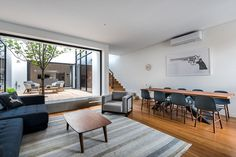 """Claremont Residence: A Private Home to Entertain Guests and Could """"Lock and Leave"""""""