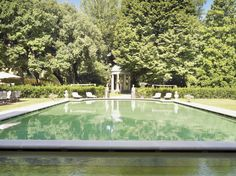 The pool has this unique colour because the sides and bottom have been painted a light brown:  this, with the reflection in the water of the sky, has a clear green effect