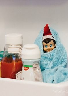 DONE...Elf on the Shelf...Bundled up in the fridge. Send the kids in to get their milk cups in the morning. :)