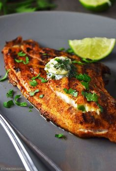 Grilled blackened catfish with cilantro-lime butter is a mildly spicy and limey dish that's brought together with fresh cilantro, butter, and garlic.