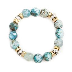 Add a dash of color with this flattering stretch bracelet in handset tealhued stone and antique silver and cz charms.