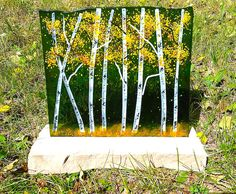 Bring the beauty of aspens indoors! This large fused glass aspen panel will grace your mantle or display table. Measuring appx. 12 x 10.5, each design is a one of a kind tribute to the enduring beauty of these transforming trees. Each piece is custom made, so your piece may differ slightly from photos. * Stone display base is included.