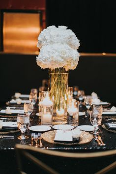 white hydrangea centerpieces.  www.andreaeppolitoevents.com  Luxury wedding at the The Palms with a black and white color theme produced by Las Vegas Wedding Planner Andrea Eppolito with photos by Kessler Photo and Film. Flowers and rentals produced by Weddings By Dzign.