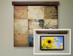 Tapestry to hide a TV. Could probably use a window shade and adhere fabric to it. Future project?