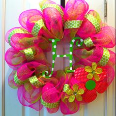 Baby girl initial mesh wreath so would do something like this for my front door but last name inital