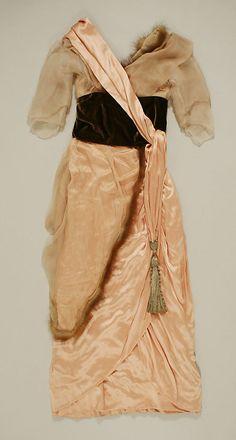 Pink silk satin afternoon dress with fur-edged chiffon overlay and brown velvet cummerbund, French, ca. 1918.