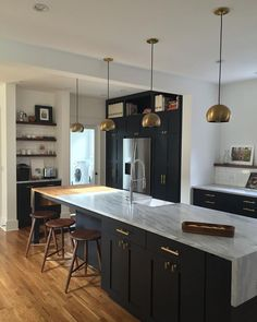 This is our newly renovated kitchen in Decatur, Georgia. The space was designed with elements that remind us of our European travels. The shaker cabinets are a nod to our historic 1925 Craftsman Bungalow. We love the rich dark Farrow and Ball paint combined with local Cherokee Marble from Georgia. Walnut accents were added for a final warming touch to the space.