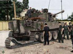PzKpfw VI Tiger tank crew replacing a track.