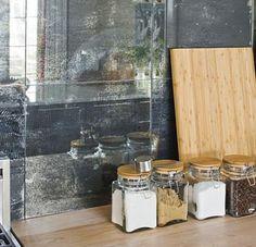 antique mirror glass backsplash in a kitchen. loveeeee it