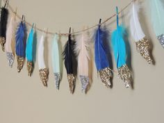 Glitter Dipped Feather Banner Glitter Tipped Feather Garland Wedding Party Baby Shower Tribal Wild One Neverland Nursery Boho Decor by JadeandJoStudio on Etsy https://www.etsy.com/listing/462248205/glitter-dipped-feather-banner-glitter