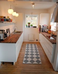 Small walk-thru kitchen, tiny galley kitchen. The butcher block countertops bring out the white cabinets and walls making this tiny kitchen look bigger - more design ideas for tiny kitchens here: outintherealworld. Galley Kitchen Design, Small Kitchen Layouts, New Kitchen, Kitchen Dining, Kitchen Floors, Country Kitchen, Ikea Galley Kitchen, Vintage Kitchen, Kitchen Cabinets