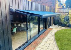 The Markilux is a contemporary full cassette patio awning with a fascinating array of colour choices and a unique styling panel. Glass Room, Most Beautiful Gardens, Outdoor Living, Outdoor Decor, Al Fresco Dining, Stunning View, Home Accents, Garden Design, Conservatory