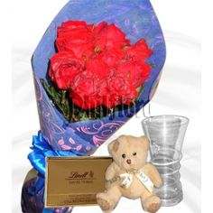 Because your sweetheart deserves to be romanced twice as much, send 24 of the freshest red roses to your wife on her birthday beautifully arranged by our floral artists in a bouquet in with classic clear glass vase, a lindtt chocolate and 5-6 incher white teddy bear. M&s Chocolates, Dozen Red Roses, Online Flower Shop, White Teddy Bear, Clear Glass Vases, Graduation Day, First Anniversary, 6 Inches, Heart Shapes
