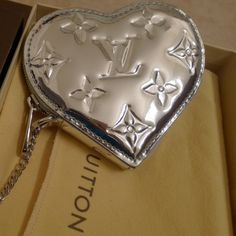 LOUIS VUITTON This silver adorable coin purse is 100% AUTHENTIC!!!!! Comes with dust bag and LV card. It has never been used. At all. I fell in love with it but it didn't match my bag. Louis Vuitton Bags
