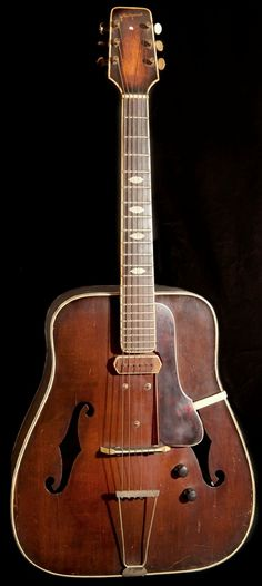 By G. Bestgen, Bern ca. 1950 - The acoustic guitar is a rustic and massive interpretation of a model by Gibson made shortly after the Second World War. The pick-up was added later by Karl Schneider, an instrument-maker of Riehen (I just think its FAT!) --- https://www.pinterest.com/lardyfatboy/