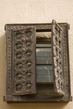 Half open wooden window shutter in old house in Kuwait, Kuwait
