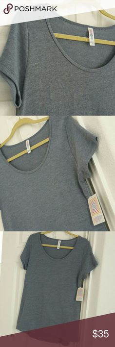 LulaRoe Washed Denim Blue Classic Tee Brand new w/tags! Soft material like a thicker tee shirt, not super thin. Muted blue is heathered with white to look like washed denim, making this a great basic solid LLR piece to coordinate with skirts & leggings! Smoke-free home. LuLaRoe Tops Tees - Short Sleeve