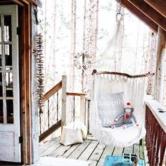The porch of a cozy Canadian treehouse. Available for rent on Airbnb, in Durham, ON.
