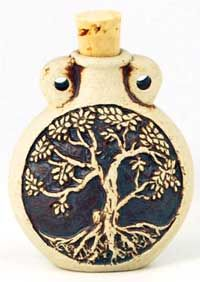 Tree of Life Oil Bottle, this clay oil bottle has been sculpted to depict the Tree of Life on both of its faces. The Tree of Life, with its deep reaching roots and broad canopy, is a powerful symbol for the union of Heaven and Earth and the forces that connect and unite all things.  www.ancient-wisdoms.com