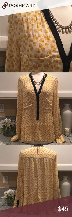 🌾Anthropologie Blouse🌾 Anthropologie (vanessavirginia) beautiful blouse in yellow/white print and black trim detail on collar and sleeves. Has two top front pockets. The sleeves can be worn folded and buttoned up with strap. 100% Rayon. In excellent condition. Anthropologie Tops Blouses