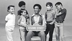 """Bill Cosby on """"Sesame Street"""" in 1970. He was one of the first celebrity guests on this PBS show. PBS  was founded on October 5, 1970."""