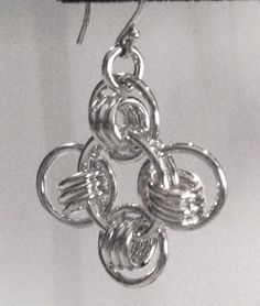 Sterling silver earrings (.925) weigh 6 grams each. Length from ear wire ball is 1.25. A measurements are approximate.
