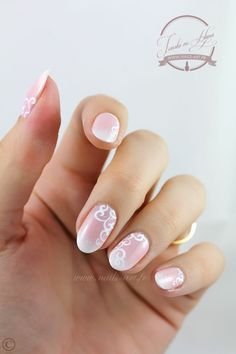 White to nude round ombre nails with stylish tribal lines