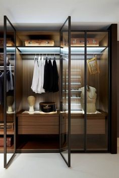 This gorgeous closet is simply wonderful and captivating. The Wooden closet with glass doors is simply phenomenal and to enhance its beauty further, it has been wonderfully lit up with the Led Lighting, giving the dark wood a very sublime appearance.