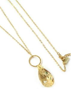22kt gold plated chain with a champagne Swarovski crystal teardrop.