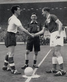 18th November 1959. England captain Ronnie Clayton shakes hands with Northern Ireland skipper Danny Blanchflower.