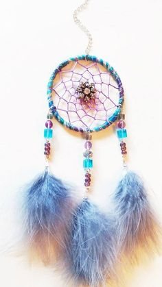 3 inch Dream Catcher - handmade with wool yarn, glass beads, metal and crystal flower, and grey marabou feathers. You can see more designs at https://www.facebook.com/pages/Dreamscape/471890606282556