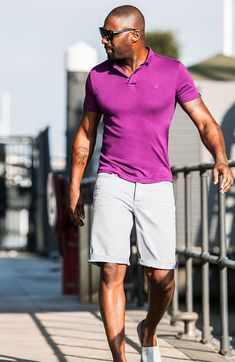 Pink Polo styled with Light Grey Shorts and White Shoes