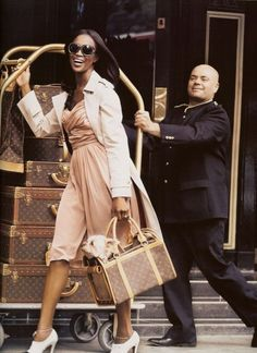 Naomi Campbell and her elite cadre of Louis Vuitton luggage