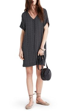 Madewell Novel Chalkboard Stripe Dress. Slim, elongating strips pattern this drapey throw-on-and-go shift dress, adding plenty of sophistication so it's just as versatile for date night as it is for daytime.