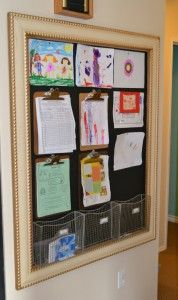 picture frame with painted background, clipboards and tacks to display and organize my kids artwork and school papers