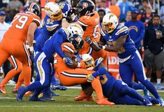Broncos vs. Chargers:   October 13, 2016  -  21-13, Chargers   -       Denver Broncos running back C.J. Anderson (22) gets wrapped up by San Diego Chargers linebacker Korey Toomer (56) and San Diego Chargers inside linebacker Jatavis Brown (57) during the first quarter against the San Diego Chargers October 13, 2016 at Paul Brown Stadium.