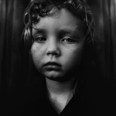 An old soul is peeking through those young sad eyes...photography by Lee Jeffries