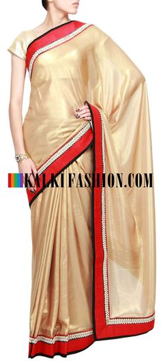 Get this beautiful golden saree here: http://www.kalkifashion.com/half-and-half-saree-in-gold-and-maroon-embellished-in-kundan-and-zardosi-only-by-kalki.html Free shipping worldwide. #50ShadesOfGold