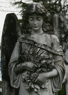 nasty beautiful angel guarding the dead...