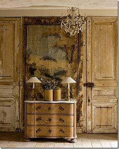 Tapestry and weathered paneling in french style interior